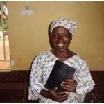 Woman smilling with Bible